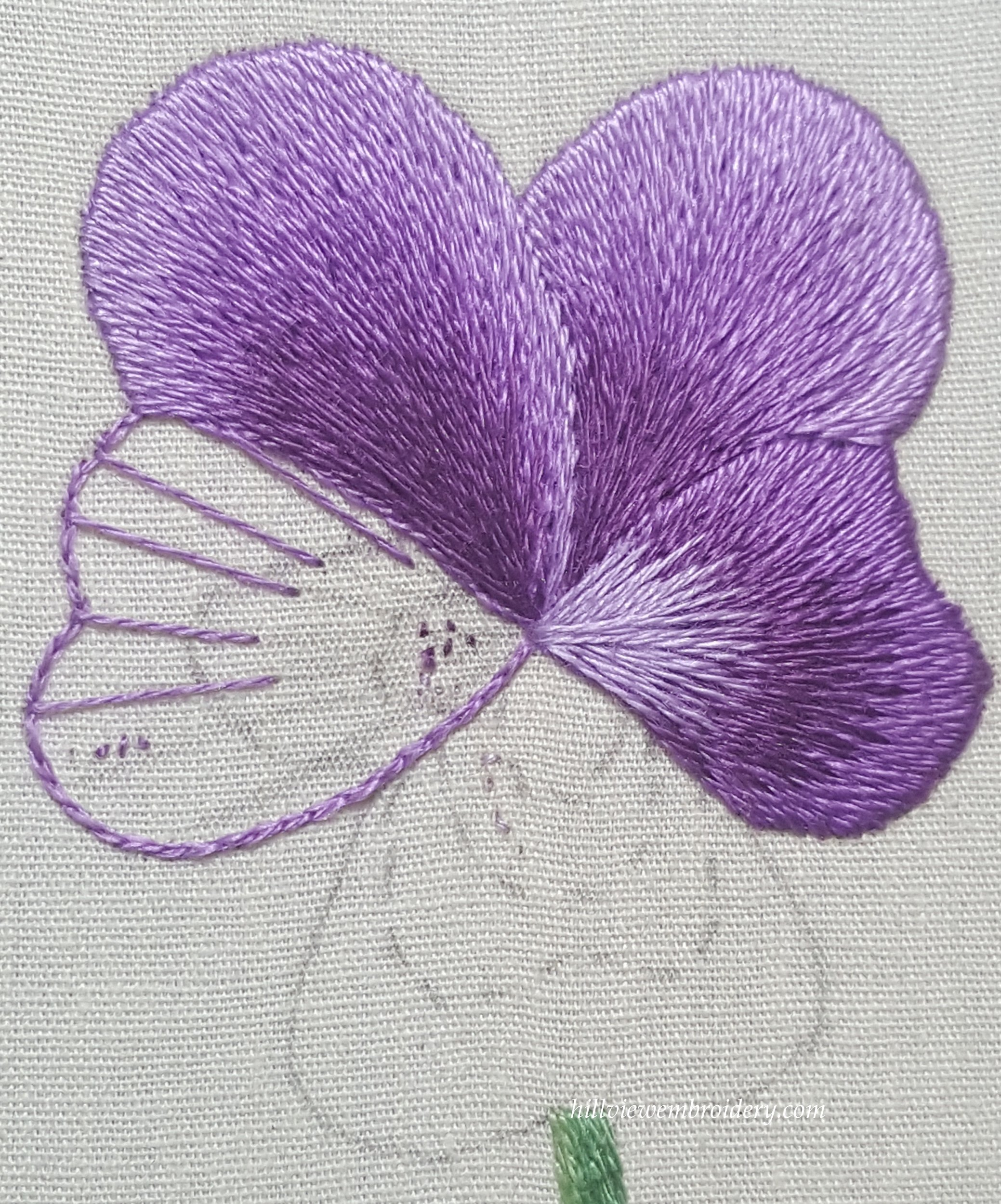 The pansy is starting to blossom hillview embroidery