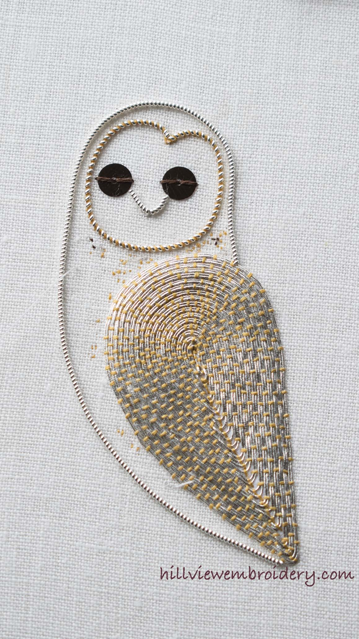 The owl's body is appearing. The body and face are stitched in pearl purl